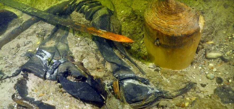 The soldier found at the bottom of a lake after century is still wearing leather boots